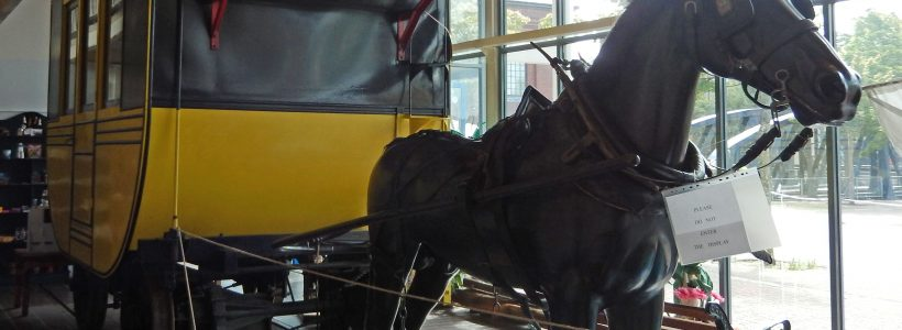 Replica horse-drawn carriage first used to carry passengers along the Oystermouth Railway at The Tram Shed, Swansea Museum
